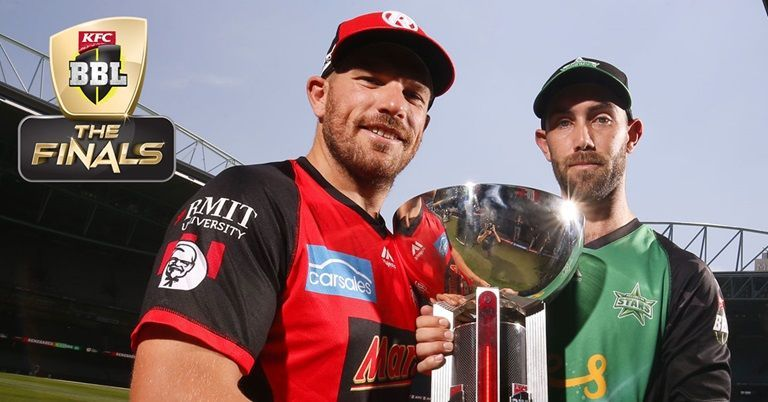 Aaron Finch and Glenn Maxwell pose with the trophy ahead of the final