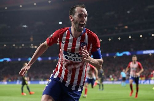 Godin celebrates after scoring a goal against Juventus in the Champions League