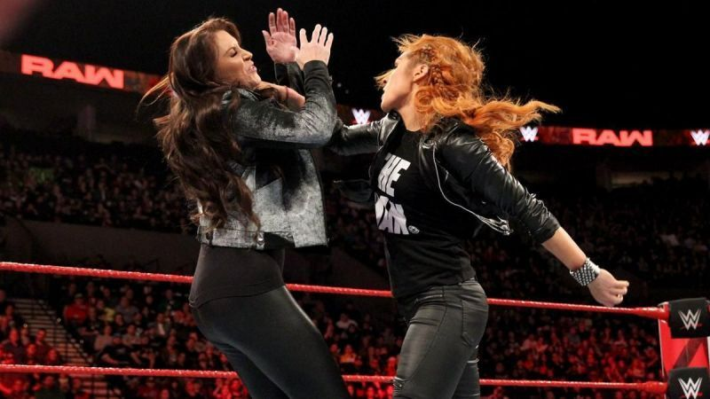 Becky Lynch attacking Stephanie McMahon.