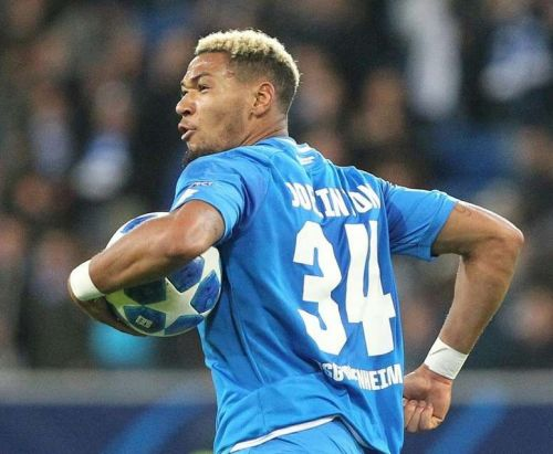Joelinton celebrates after scoring in the Champions League