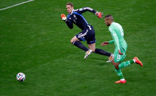 Manuel Neuer ready to tackle an Algerian player in the Round of 16 of the FIFA World Cup, 2014.