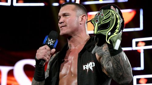 Randy Orton lays claim to Rey Mysterio's mask after a brutal beatdown