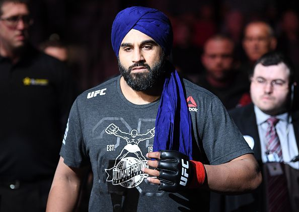 Arjan Singh Bhullar makes his way to the Octagon in his Turban