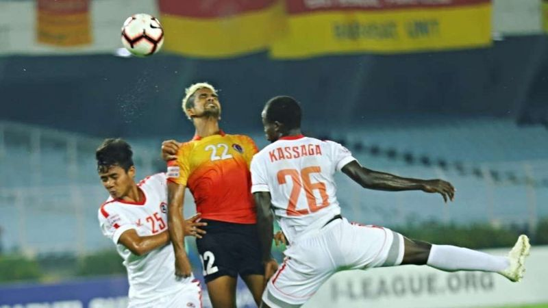 Jobby Justin in action along with two Aizawl players on Monday evening