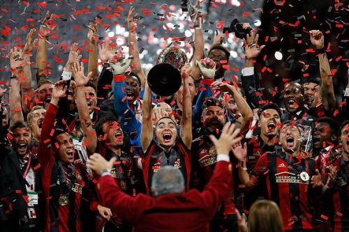 Atlanta players celebrate winning the 2018 MLS Cup, just a season after the club's inception
