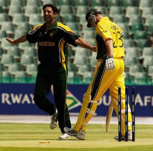 Wasim Akram of Pakistan celebrates the wicket of Matthew Hayden of Australia