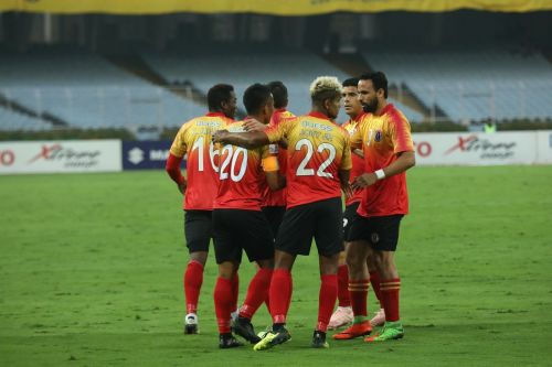 East Bengal players celebrate after scoring a goal