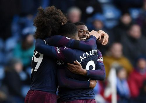 Arsenal scraped past Huddersfield