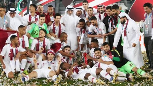 The triumphant Qatar team with the trophy