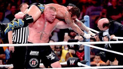 Brock Lesnar and CM Punk with Paul Heyman