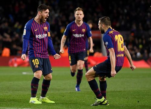 Barcelona players celebrate after the second goal