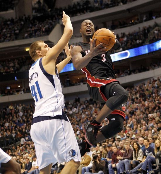 Dwayne Wade and Dirk Nowitzki go at it, one more time