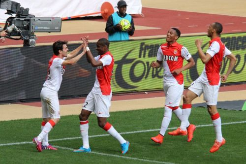Fabinho and Martial celebrating a goal with their Monaco teammates.