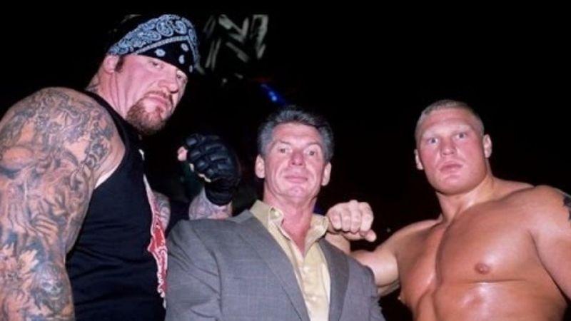 Brock Lesnar with The Undertaker and Vince McMahon
