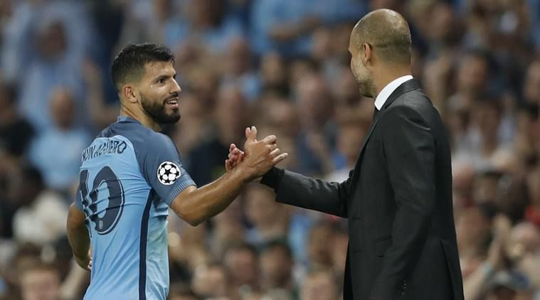 Sergio Kun Aguero (l) and Pep Guardiola (r)