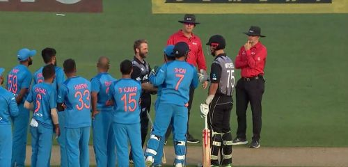 Rohit Sharma and MS Dhoni having a discussion with the two batsmen and the umpires