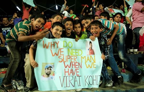A group of young fans showing their love for Virat Kohli At