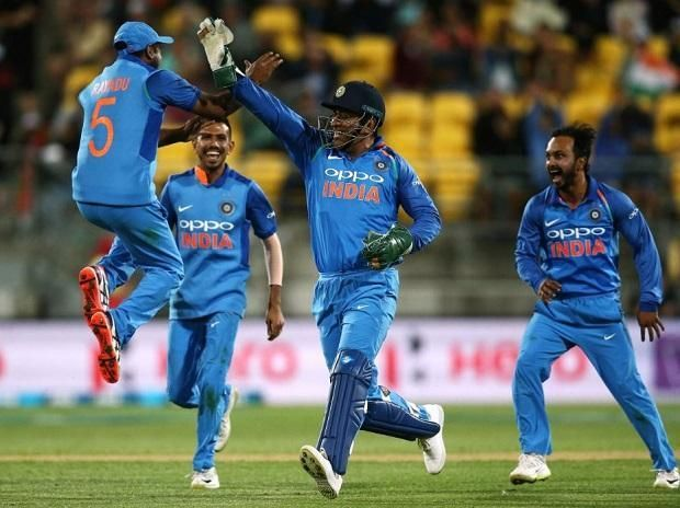 Dhoni celebrates after running out Jimmy Neesham