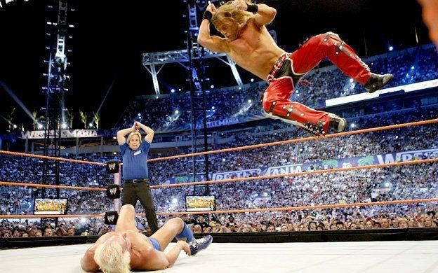 HBK in mid-air, looking for an elbow drop on Flair!