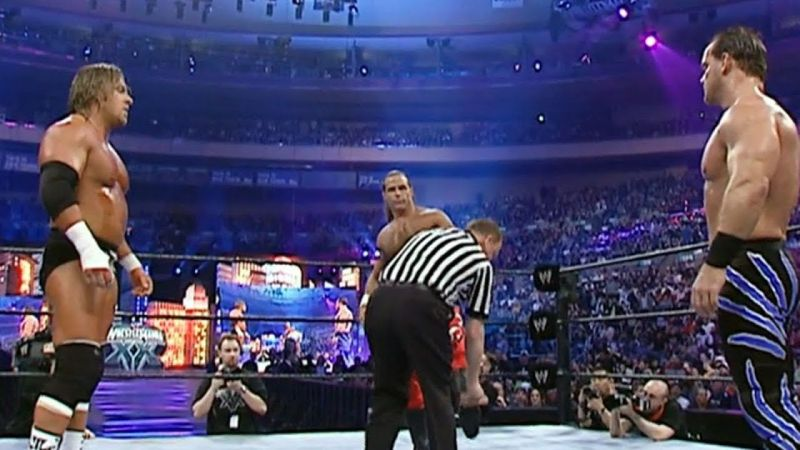 Benoit, Triple H, and Shawn Michaels stare each other down