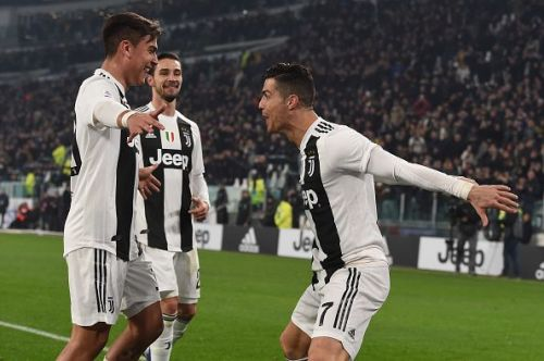 Cristiano Ronaldo and Paulo Dybala celebrate