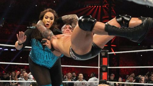 Randy Orton's face is all business as he drives Nia Jax to the mat with an RKO during the Men's Rumble