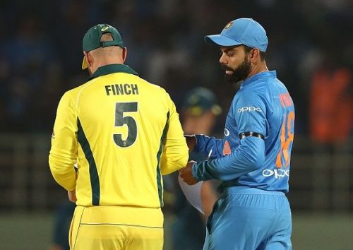 The competing captains Aaron Finch and Virat Kohli before the match got underway