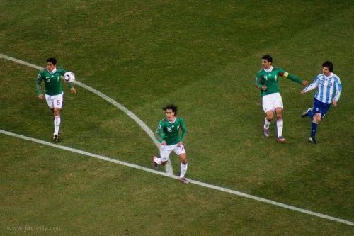 World Cup 2010, Round of 16: Rafa Marquez and his Mexican teammates helplessly follow the ball as Messi attempts a chip. Photograph: Javierly/LaLllama/Flickr