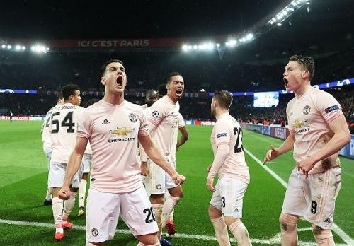 Manchester United players celebrate Marcus Rashford's winner against Paris Saint-Germain.