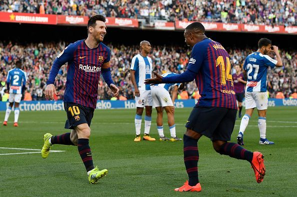 Malcom wheels away to celebrate with Messi after creating his first La Liga assist late on