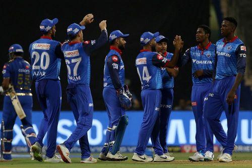 The Delhi Capitals celebrate the fall of Kieron Pollard's wicket (Image Courtesy: IPLT20)