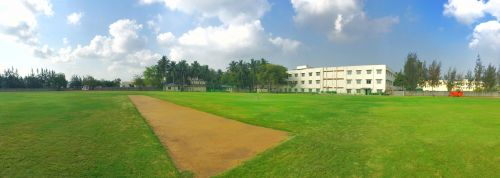 The state-of-the-art cricket ground has a lush green grass outfield