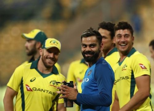 Virat Kohli alongside Australian team