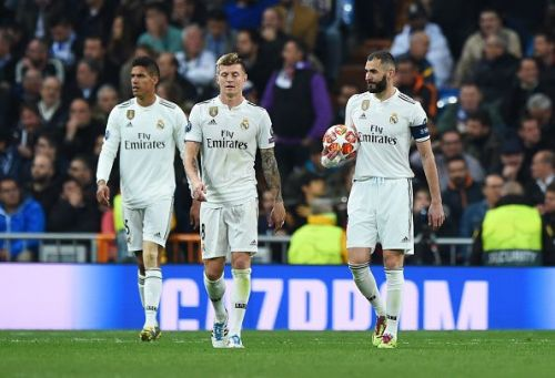 Kroos (centre) endured a difficult evening as Ajax overran Real in midfield to devastating effect