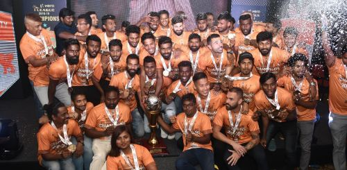 Chennai City players celebrate with the I-League trophy