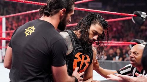 Seth Rollins helping Roman Reigns to the back on RAW