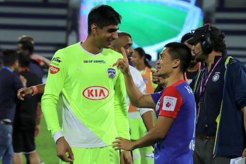 Gurpreet Singh Sandhu (left) of Bengaluru FC, always sporting a flashy jersey, with captain Sunil Chhetri