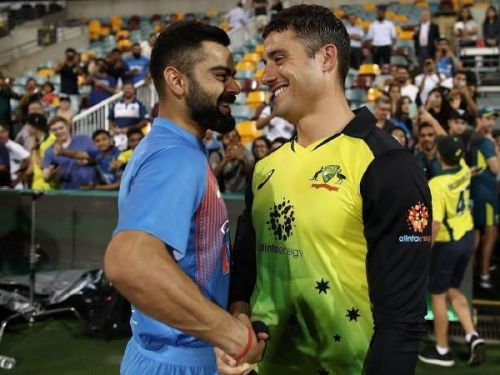 Virat Kohli and Marcus Stoinis sharing a light moment