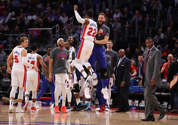The Detroit Pistons celebrate a victory