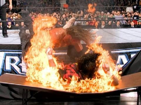 Edge spears Foley on a flaming table