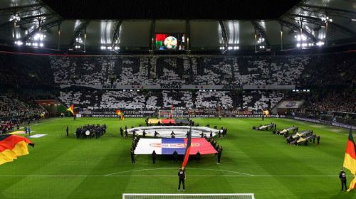 German fans hold up display at the Volkswagen Arena reading