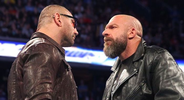Batista and Triple H staring each other down!