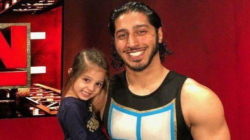 Mustafa Ali posing with his daughter