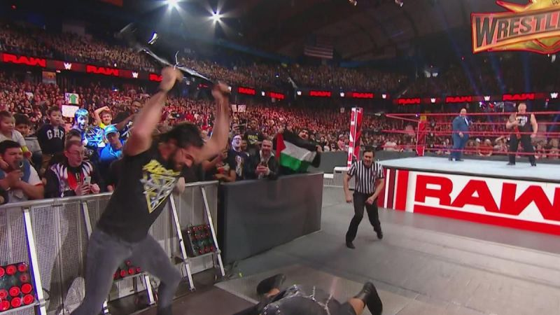 Rollins unloaded on McIntyre with a chair