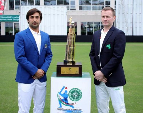 Asghar Afghan & William Porterfield with the test trophy