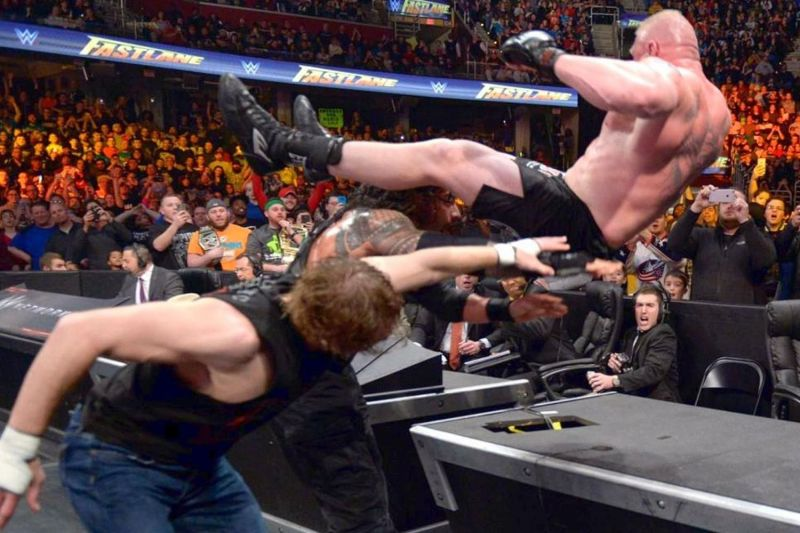 roman and dean hit power bomb to brock lesnar