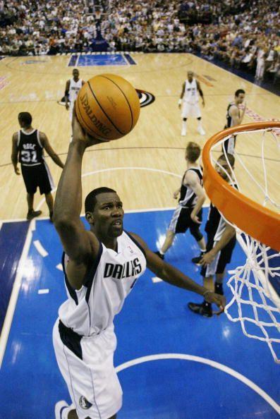 Michael Finley dunks the ball against San Antonio Spurs