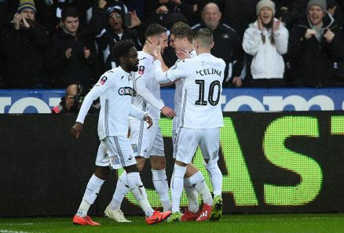 Swansea City celebrating their goal against Manchester City - FA Cup Quarter Final