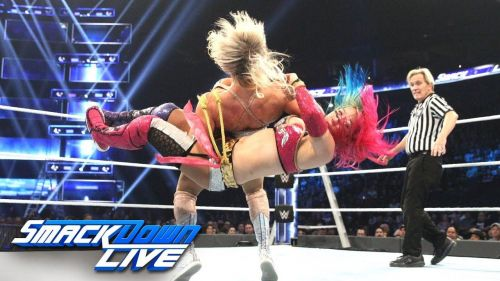 The Empress dethroned by a Queen; Asuka attempts a crucifix on Charlotte.