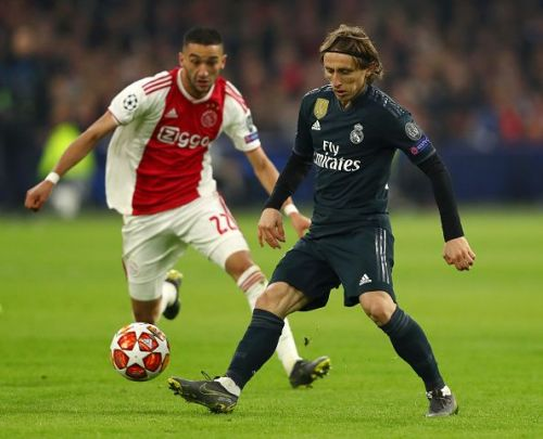 Luka Modric and Hakim Ziyech in action